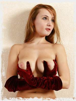 Busty blonde babe Kamelia just in the red gloves