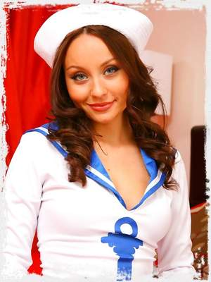 Carla looks ship shape as she slowley teases her way out of her gorgeous sailors outfit