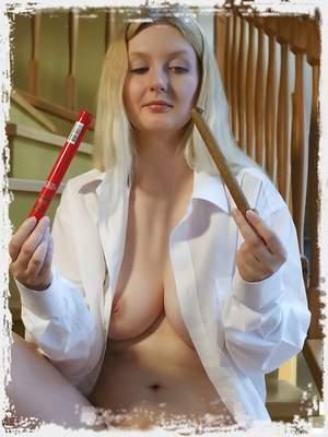 Lotta S masturbates her plump pussy with her dildo.