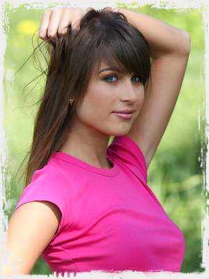 Young and sexy brunette in search of escape in the wood.