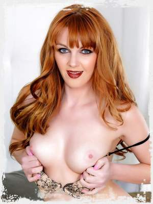 Beautiful redhead Marie McCray exposes her incredible body and fingers her wet pussy