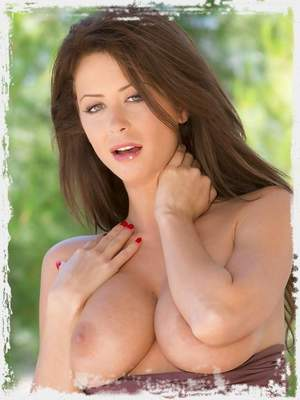 Busty brunette babe Emily Addison strips off and spreads her pink pussy