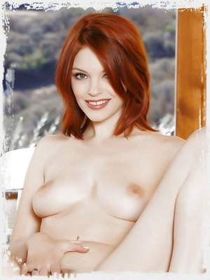 Hot redhead Bree Daniels opens her long legs to offer her pussy